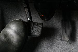 Depressing the brake pedal