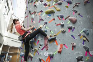 woman rock climbing indoors