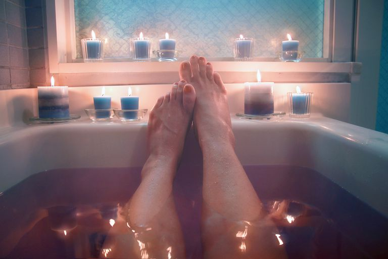 woman taking a bath by candlelight