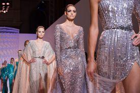 Fashion models walk the runway at a show in Paris.