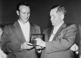 Arnold Palmer with Bobby Jones after Palmer's win in the 1958 Masters