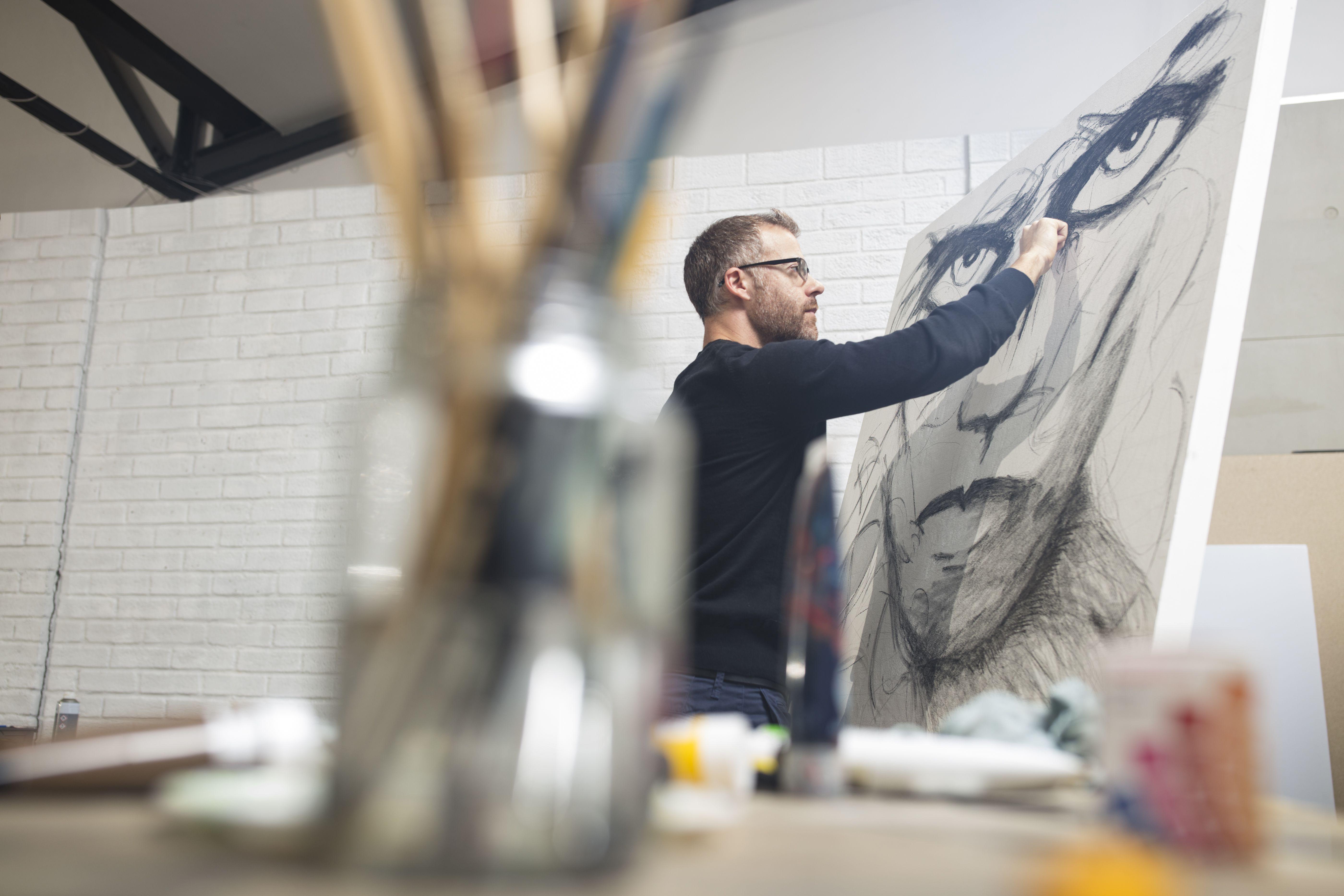 Man checking drawing in studio