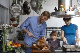 Family preparing Thanksgiving dinner