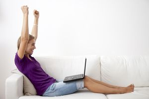 Woman entering sweepstakes on her laptop.