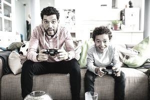 Dad and Kid Playing Video Games