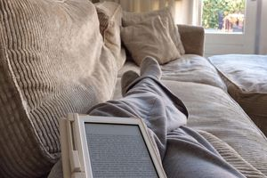 Person reading ebook on couch