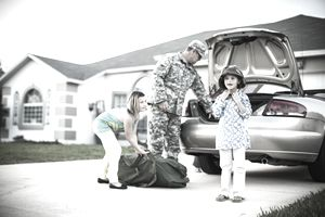 a soldier with two young children