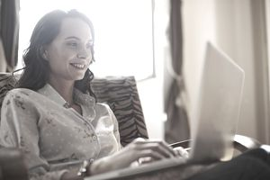 Young woman on laptop at home