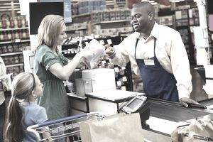 Checking out with coupons at grocery store