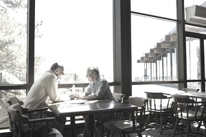 Mature Couple holding hands in restaurant