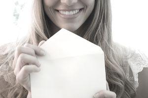 USA, New Jersey, Jersey City, Portrait of blonde woman holding envelope
