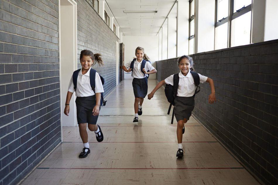 Schoolgirl running in the corridors
