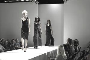 Spectators watching fashion models on catwalk