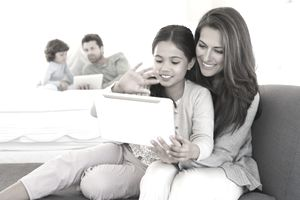 Image of parents and kids using computers together, illustrating About.com's Kids' Sweepstakes List.