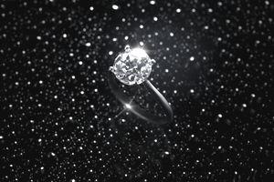 Diamond ring against starry sky
