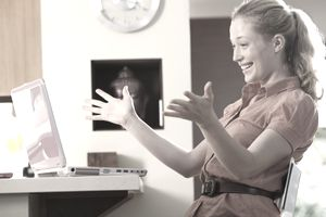 Thrilled woman at a computer, illustrating About.com's Instant Sweepstakes List.