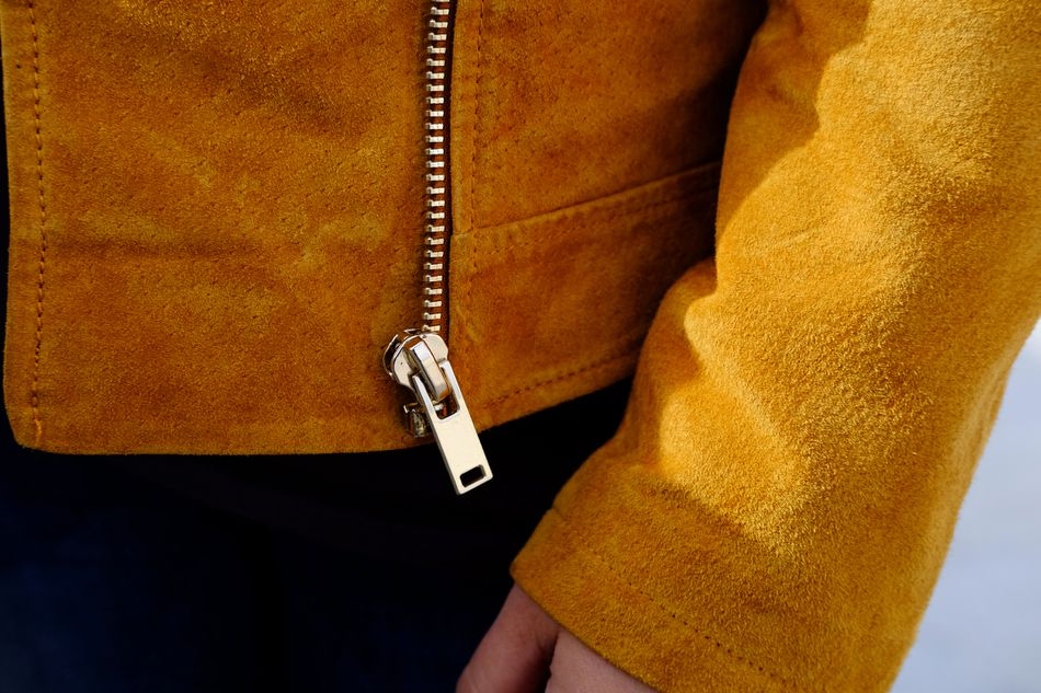 Midsection of woman wearing zippered coat