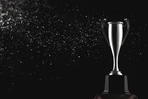 Close-Up Of Trophy Against Black Background
