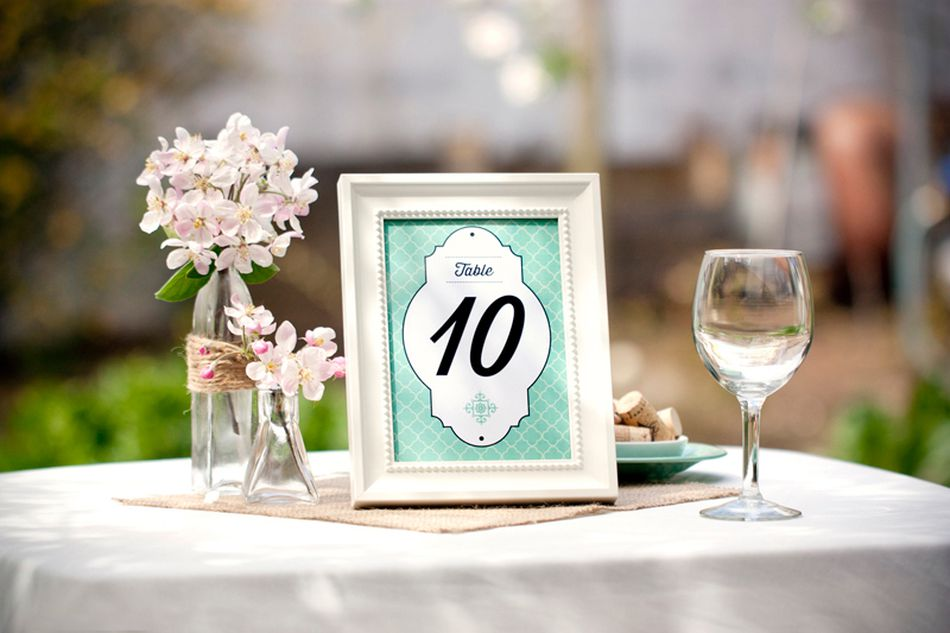 A green wedding table number in a frame.