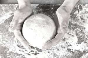 Chef Kneading Pizza Dough