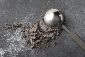 Directly Above Shot Of Cocoa Powder With Measuring Spoon On Table