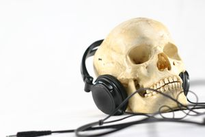 A skull with headphones on.