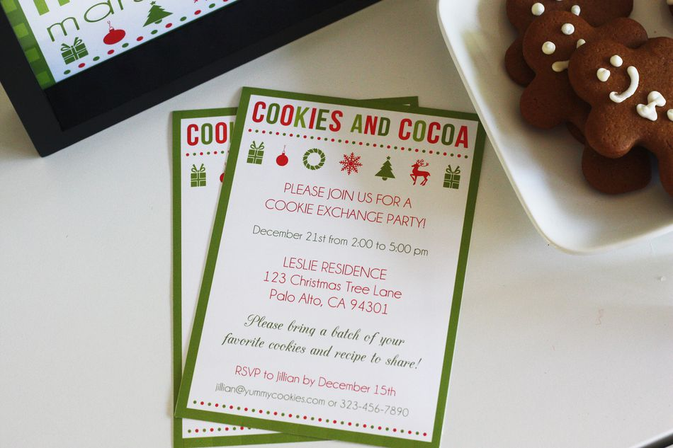 A Cookies and Cocoa Christmas party invitation laying on a table