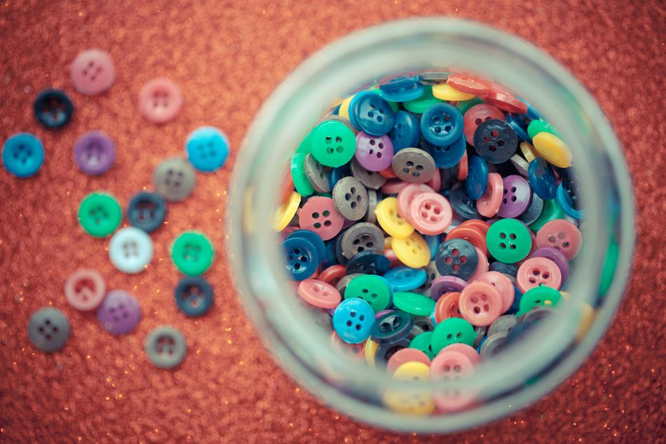 Colourful buttons in a jar