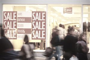Shoppers entering a store.