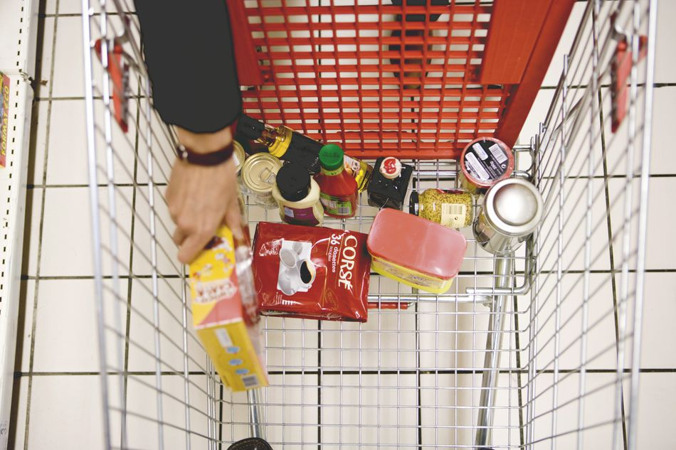 Woman loading grocery cart