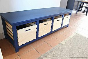 A blue storage bench with room for shoes.