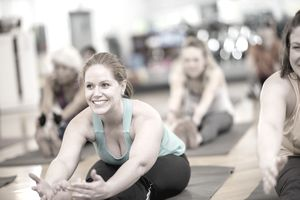 Forward Fold in Yoga Fitness Class