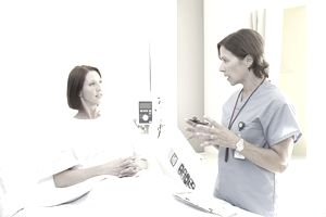 Doctor consulting patient in hospital