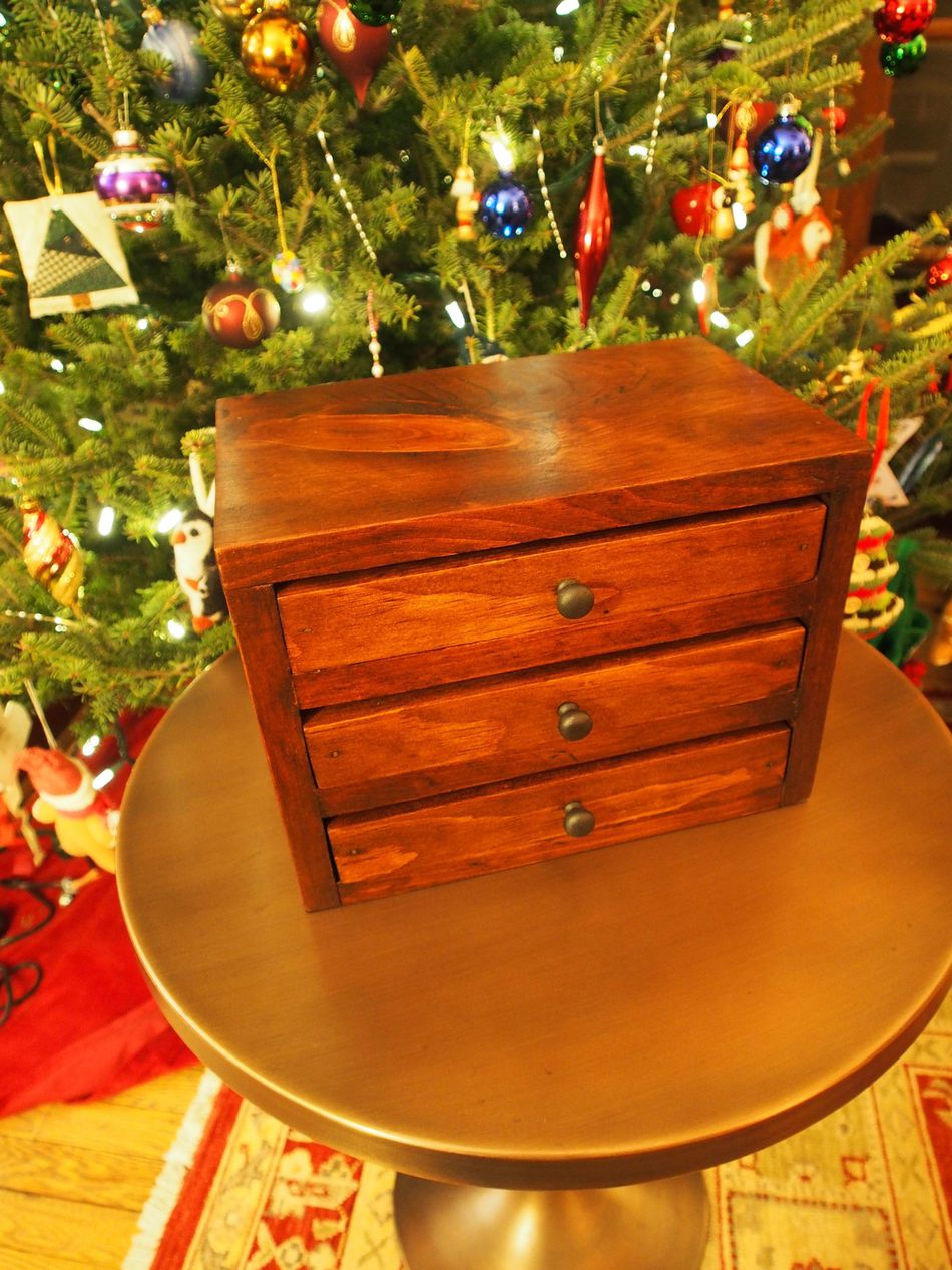 A Diy Jewelry Box In Front Of Christmas Tree