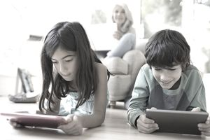 Family using devices to watch streamed content