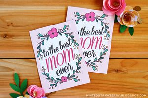"""Two cards on a table that say """"to the best mom ever"""""""