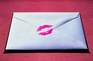 An envelope with a lipstick kiss on it