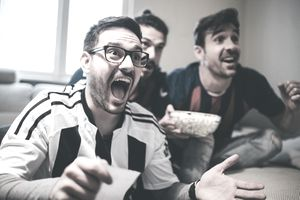 Group of Men Watching a Game