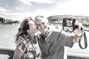 Older couple taking self portrait