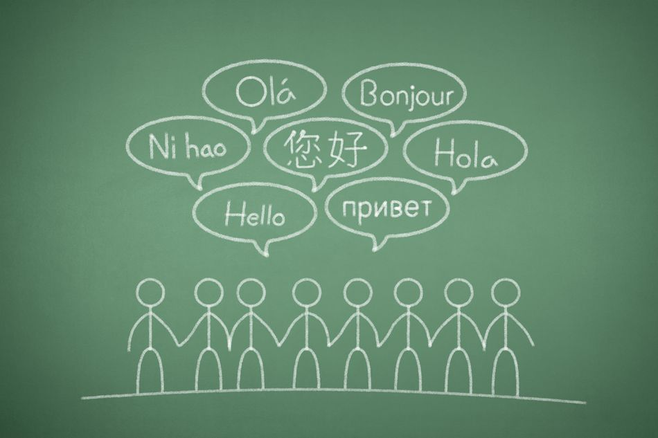 """A chalkboard with stick figures saying """"hello"""" in different languages."""