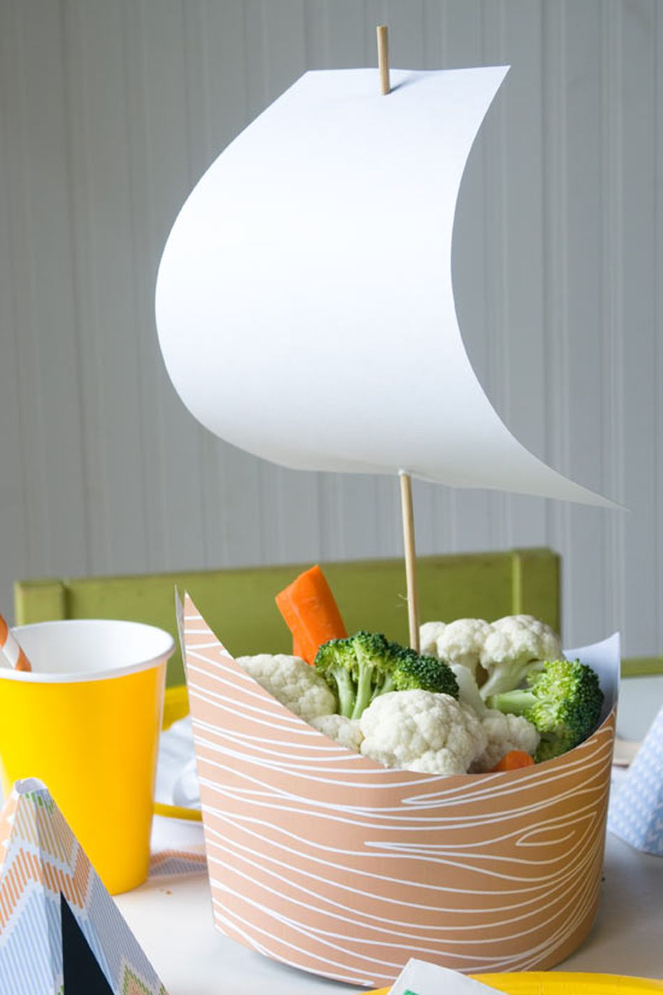 A paper pilgrim boat on a table.